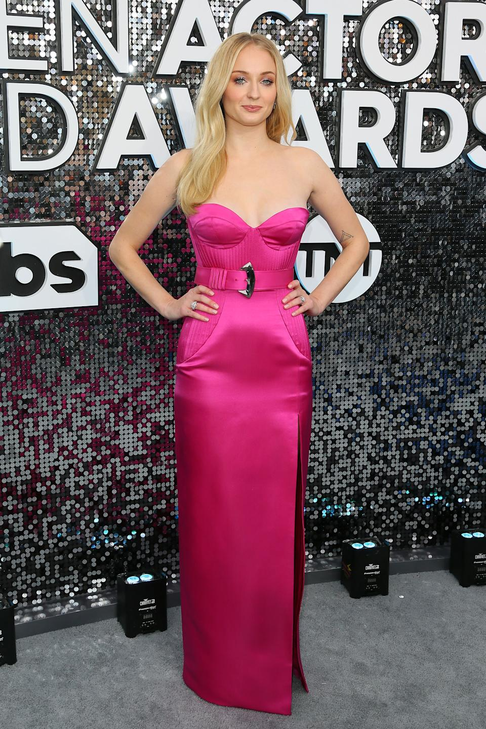 """<h2>Sophie Turner in Louis Vuitton</h2><br>Sophie Turner waves her role as the Queen in the North goodbye with a bang in this hot pink belted gown. <span class=""""copyright"""">Photo by JEAN-BAPTISTE LACROIX/AFP via Getty Images.</span>"""