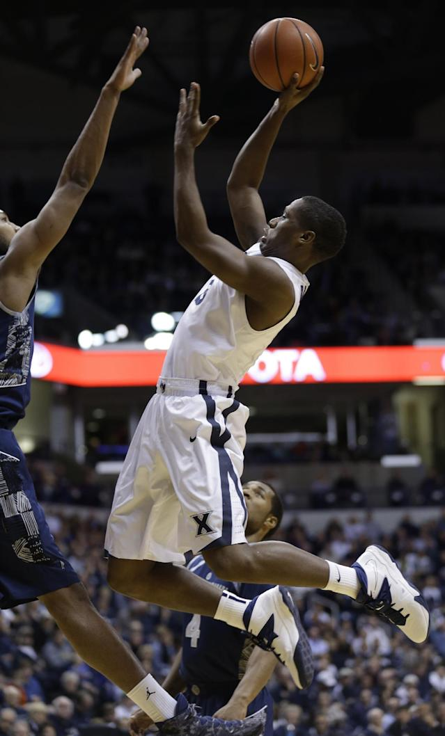Xavier guard Brandon Randolph drives against Georgetown in the first half of an NCAA college basketball game on Wednesday, Jan. 15, 2014, in Cincinnati. (AP Photo/Al Behrman)