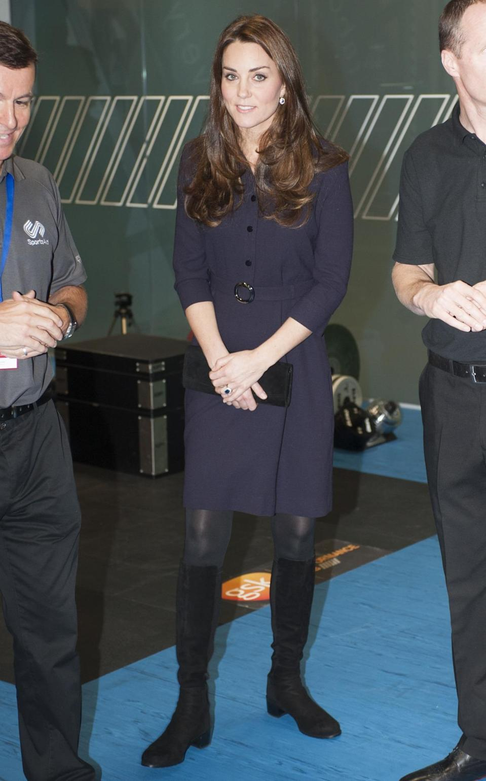 <p>For a sports workshop, Kate wore a chic shirtdress from Goat along with knee high boots by Stuart Weitzman. She also carried a coordinating bag by Stuart Weitzman. </p><p><i>[Photo: PA]</i></p>