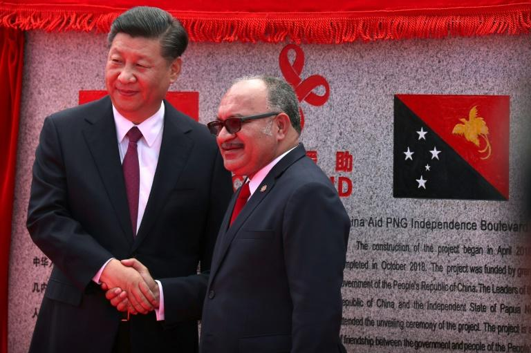 "Xi Jinping unveiled a plaque marking the new ""Independence Boulevard"" outside Papua New Guinea's parliament"