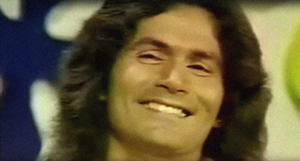 Rodney Alcala grinning after being asked a question on The Dating Game