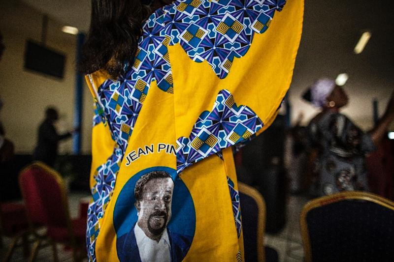 A woman wearing a dress with the portrait of Gabonese opposition leader Jean Ping, dances at chruch on September 4, 2016 in Libreville (AFP Photo/Marco Longari)