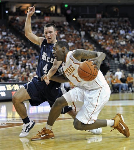 Texas guard Sheldon McClellan, right, tries to drive against Rice guard Connor Frizzelle during the first half of an NCAA college basketball game Saturday, Dec. 31, 2011, in Austin, Texas. (AP Photo/Michael Thomas)