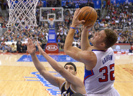 Los Angeles Clippers forward Blake Griffin, right, puts up a shot as Utah Jazz center Enes Kanter defends during the first half of an NBA basketball game, Saturday, Feb. 1, 2014, in Los Angeles. (AP Photo/Mark J. Terrill)