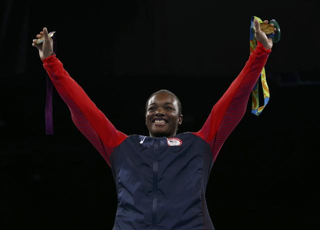 2016 Rio Olympics - Boxing - Victory Ceremony - Women's Middle (75kg) Victory Ceremony - Riocentro - Pavilion 6 - Rio de Janeiro, Brazil - 21/08/2016. Gold medallist Claressa Shields (USA) of USA poses with her medals from Rio 2016 (R) and London 2012. REUTERS/Peter Cziborra FOR EDITORIAL USE ONLY. NOT FOR SALE FOR MARKETING OR ADVERTISING CAMPAIGNS.