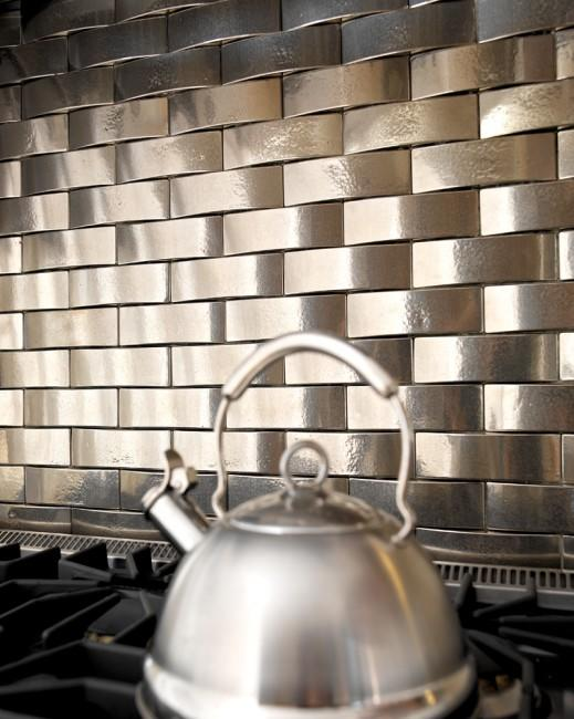 """This curved <a href=""""http://bit.ly/SOqLUR"""" rel=""""nofollow noopener"""" target=""""_blank"""" data-ylk=""""slk:border tile from Rocky Mountain Hardware, made of solid bronze"""" class=""""link rapid-noclick-resp"""">border tile from Rocky Mountain Hardware, made of solid bronze</a>, can be used to create a 3-D effect. This is the white bronze option with a light patina.<br><br>Inspired yet? <a href=""""http://yhoo.it/SOyLVO"""" rel=""""nofollow noopener"""" target=""""_blank"""" data-ylk=""""slk:Visit our Project Center for easy-to-follow instructions on installing a backsplash yourself."""" class=""""link rapid-noclick-resp"""">Visit our Project Center for easy-to-follow instructions on installing a backsplash yourself.</a>"""