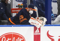 Edmonton Oilers goalie Mikko Koskinen (19) sits on the bench after being pulled for letting in four goals by the Vancouver Canucks during second-period NHL hockey game action in Edmonton, Alberta, Thursday, May 6, 2021.. (Jason Franson/The Canadian Press via AP)