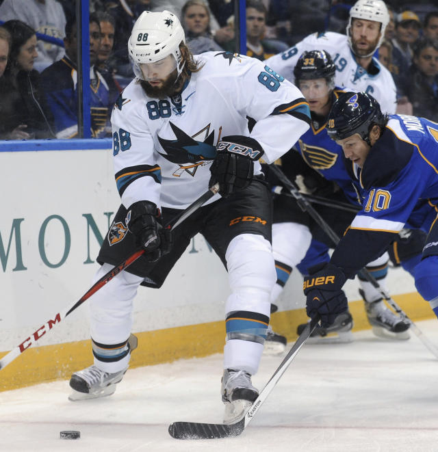 San Jose Sharks' Brent Burns (88) gets the puck by St. Louis Blues' Brenden Morrow (10) during the first period of an NHL hockey game Tuesday, Oct. 15, 2013, in St. Louis. (AP Photo/Bill Boyce)
