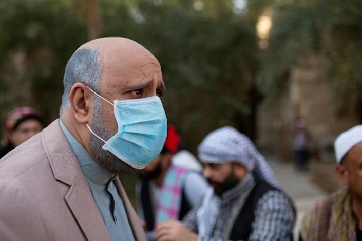 In one skit from the parody adaptation of the long-running Syrian TV drama, 'Bab al-Hara', the show's main character Abu Issam, played by Iraqi artist Mohammad Qassem, scolds his son to 'put on your mask!' (AFP Photo/Hussein FALEH)