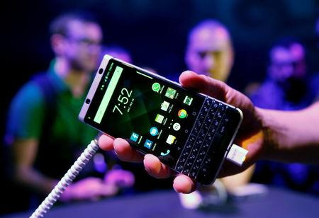 FILE PHOTO: A man holds the new BlackBerry Key One before the Mobile World Congress in Barcelona