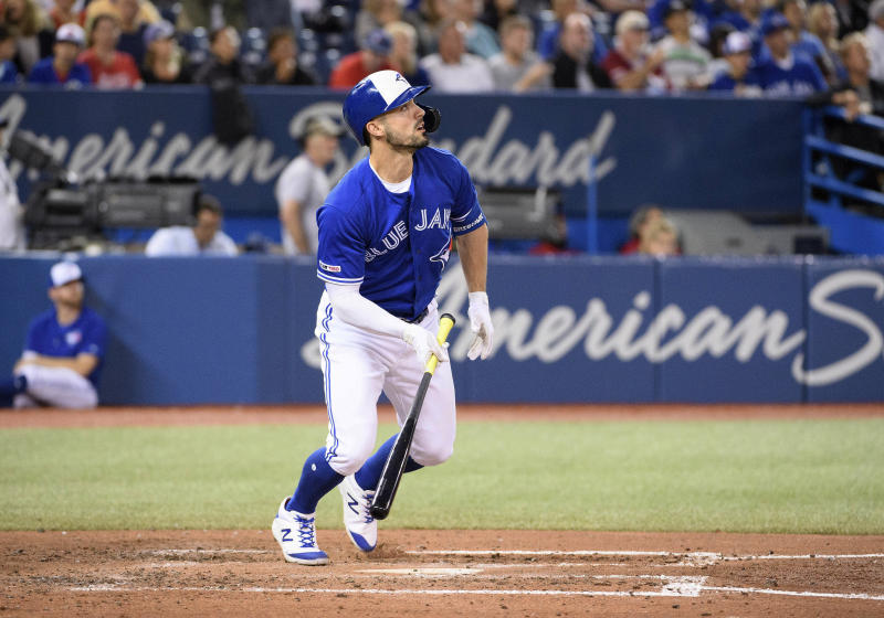 Sep 15, 2019; Toronto, Ontario, CAN; Toronto Blue Jays center fielder Randal Grichuk (15) hits a home run against the New York Yankees during the third inning at Rogers Centre. Mandatory Credit: Nick Turchiaro-USA TODAY Sports