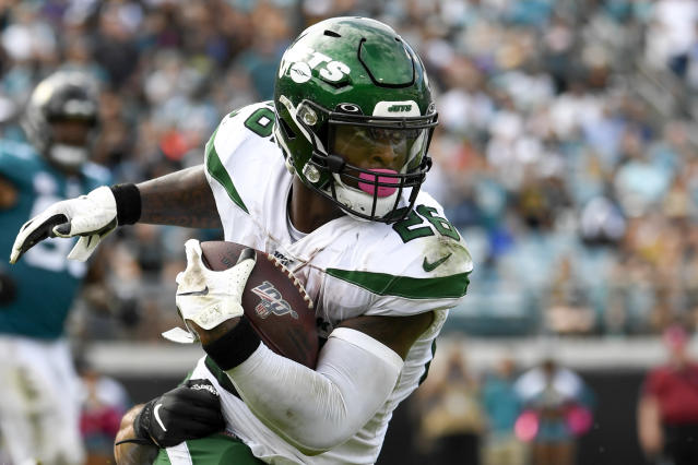 Oct 27, 2019; Jacksonville, FL, USA; New York Jets running back Le'Veon Bell (26) runs the ball during the fourth quarter against the Jacksonville Jaguars at TIAA Bank Field. Mandatory Credit: Douglas DeFelice-USA TODAY Sports
