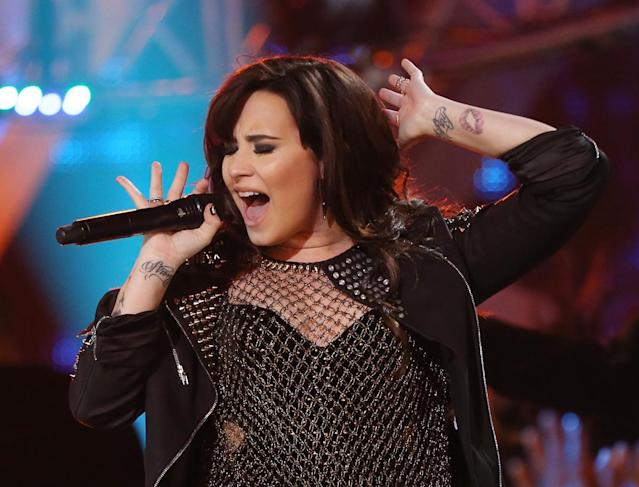 <p>Lovato has roughly 20 tattoos, one of which included an illustration of a vagina that she has since covered up with a flower. (Photo: Getty Images) </p>