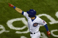 Chicago Cubs' David Bote points after he hits a three-run home run during the sixth inning of Game 2 of a baseball doubleheader against the St. Louis Cardinals, Monday, Aug. 17, 2020, in Chicago. (AP Photo/Matt Marton)