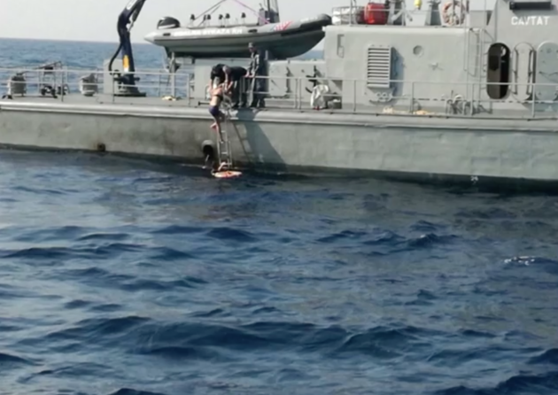 The woman being rescued by the Croatian coast guard vessel.