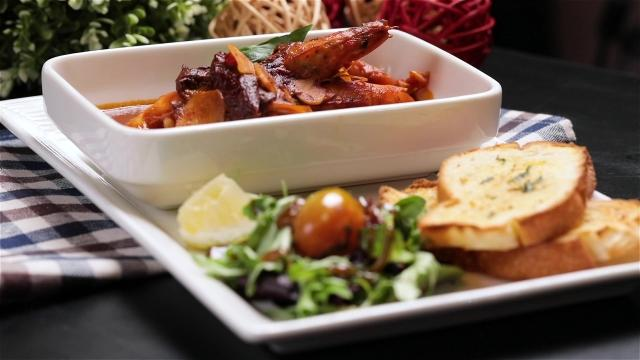 Prawns in Spicy Italian Sauce with garlic bread and salad from Zazz pizza