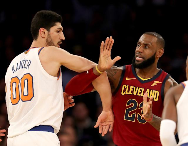 Enes Kanter and LeBron James fight for position during the Cleveland Cavaliers' 104-101 victory. (Elsa via Getty Images)