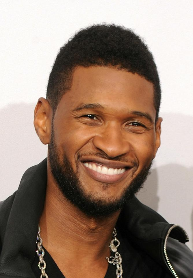 LOS ANGELES, CA - NOVEMBER 21:  Recording Artist Usher, winner of Soul/R&B Favorite Album Award and Soul/R&B Favorite Male Artist Award, poses in the press room during the 2010 American Music Awards held at Nokia Theatre L.A. Live on November 21, 2010 in Los Angeles, California.  (Photo by Jason Merritt/Getty Images for DCP)