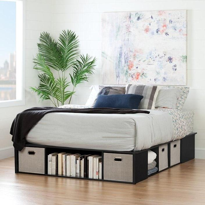 "<p>This storage bed leverages cubbies over drawers, perfect for an open-shelving enthusiast. It comes with grey upholstered storage bins, but you could swap them out for any <a href=""https://www.architecturaldigest.com/decorating-with-color?mbid=synd_yahoo_rss"" rel=""nofollow noopener"" target=""_blank"" data-ylk=""slk:color"" class=""link rapid-noclick-resp"">color</a> to create a bespoke look. This bed is available in black or white.</p> <p><strong>Sizes Available:</strong> Twin, full, queen, and king </p> <p><strong>Star Rating:</strong> 4.4 out of 5</p> <p><strong>Customer Review:</strong> ""If you have a small space and need extra storage, this does the trick. Viewable cubbies are deeper and roomier than the pictures might lead you to believe. Plus, because the bed frame has no bottom and sits directly on the floor, you can pack the inside with heavy boxed junk--like seven years of tax documents that you really don't want to access but need to keep. Seven standard 'banker's boxes' fit inside the inner frame, resting on your own floor covered by the support and mattress, and nobody knows they are in there, but you."" —<em>Rev</em></p> $497, Wayfair. <a href=""https://www.wayfair.com/furniture/pdp/south-shore-flexible-storage-platform-bed-w002859866.html"" rel=""nofollow noopener"" target=""_blank"" data-ylk=""slk:Get it now!"" class=""link rapid-noclick-resp"">Get it now!</a>"