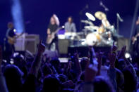"""Vaccinated guests react to the Foo Fighters performance at """"Vax Live: The Concert to Reunite the World"""" on Sunday, May 2, 2021, at SoFi Stadium in Inglewood, Calif. (Photo by Jordan Strauss/Invision/AP)"""