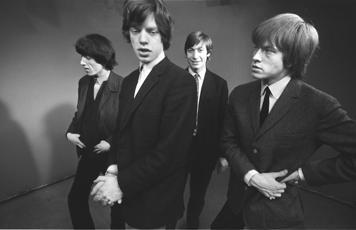 UNITED KINGDOM - JANUARY 01: Photo of ROLLING STONES; L-R: Bill Wyman, Mick Jagger, Charlie Watts, Brian Jones posed, studio, at a Melody Maker photocall (Photo by John Hoppy Hopkins/Redferns)