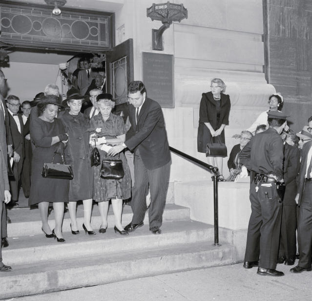 <p>The mothers of the three civil rights workers murdered in Mississippi leave the meeting hall of the Society for Ethical Culture, where funeral services were held for 20-year-old Andrew Goodman in New York City on Aug. 9, 1964. Mrs. Fanny Lee Chaney of Meridian, Mississippi, mother of James E. Chaney, is shown to the left of Mrs. Goodman (C). On Mrs. Goodman's right is the mother of Michael Schwerner, whose body arrived at Newark Airport shortly after the services for Andrew ended. (Photo: Bettmann/Getty Images) </p>