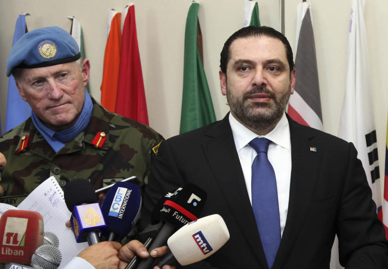 In this photo released by Lebanon's official government photographer Dalati Nohra, Lebanese Prime Minister Saad Hariri, right, speaks to journalists, as he stands next of Head of Mission and Force Commander of the United Nations Interim Force in Lebanon (UNIFIL), Maj. Gen. Michael Beary, left, at the United Nations peacekeepers headquarters, at the coastal border town of Naqoura, south Lebanon, Friday, April 21, 2017. Hariri paid a visit to south Lebanon and United Nations peacekeepers stationed along the border with Israel, a day after Hezbollah organized a tour for journalists along the frontier.(Dalati Nohra via AP)