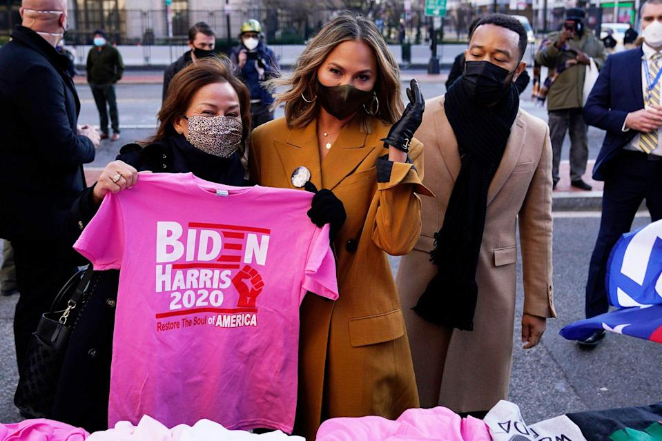 <p>John Legend, Chrissy Teigen and her mom Vilailuck stop for some Biden/Harris merch on Wednesday while in Washington, D.C., for the inauguration of President Joe Biden. </p>