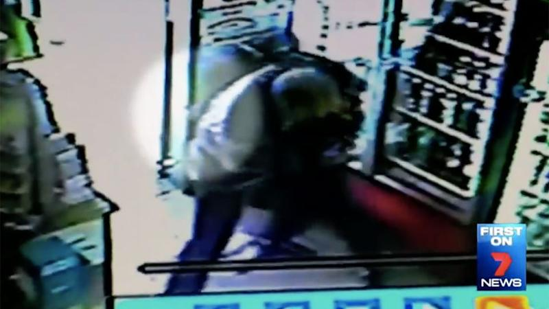 The two begin to grapple near the entrance of the door. Photo: 7 News