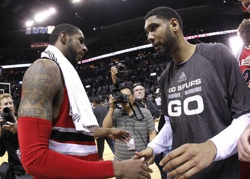 SAN ANTONIO, TX - MAY 14: Tim Duncan #21 of the San Antonio Spurs and LaMarcus Aldridge #12 of the Portland Trail Blazers shake hands after the Spurs defeat the Trail Blazers 104-82 in Game Five of the Western Conference Semifinals during the 2014 NBA Playoffs at the AT&T Center on May 14, 2014 in San Antonio, Texas. (Photo by Chris Covatta/Getty Images)