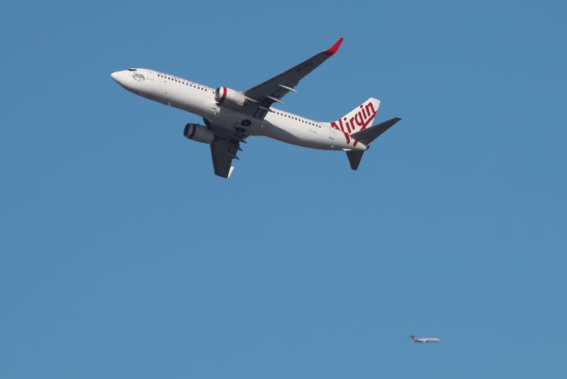 A Virgin Australia Airlines plane takes off from Kingsford Smith International Airport in Sydney