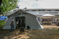 The government is distributing modular tents to struggling hospitals and re-deploying health workers from regions where virus transmission rates are low