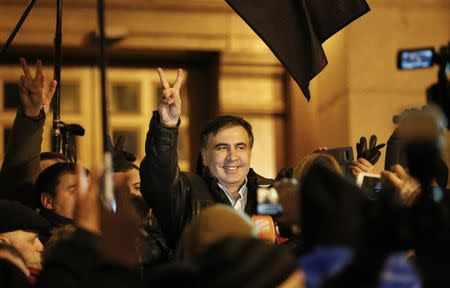 Ukrainian opposition figure and Georgian former President Mikheil Saakashvili (C) reacts after he was released from detention in Kiev, Ukraine December 11, 2017. REUTERS/Gleb Garanich