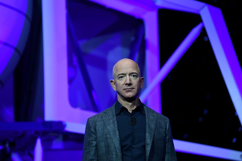 FILE PHOTO: FILE PHOTO: Founder, Chairman, CEO and President of Amazon Jeff Bezos unveils his space company Blue Origin's space exploration lunar lander rocket called Blue Moon during an unveiling event in Washington
