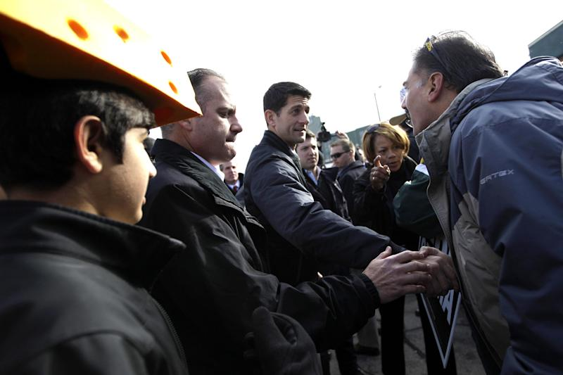 Republican vice presidential candidate, Rep. Paul Ryan, R-Wis., greets a supporter at a tailgate party for the football game between the Green Bay Packers and the Arizona Cardinals at  Lambeau Field, Sunday, Nov. 4, 2012 in Green Bay, Wis.  (AP Photo/Mary Altaffer)