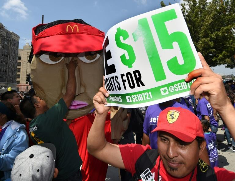 """growing number of states and cities have already enacted a wage hike at the urging of the """"Fight for $15"""" movement launched by fast-food workers in the early 2010s"""