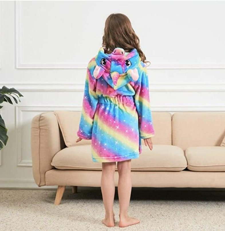 <p>This <span>Unicorn Hooded Bathrobe</span> ($14 - $27) is so bright and cheerful.</p>