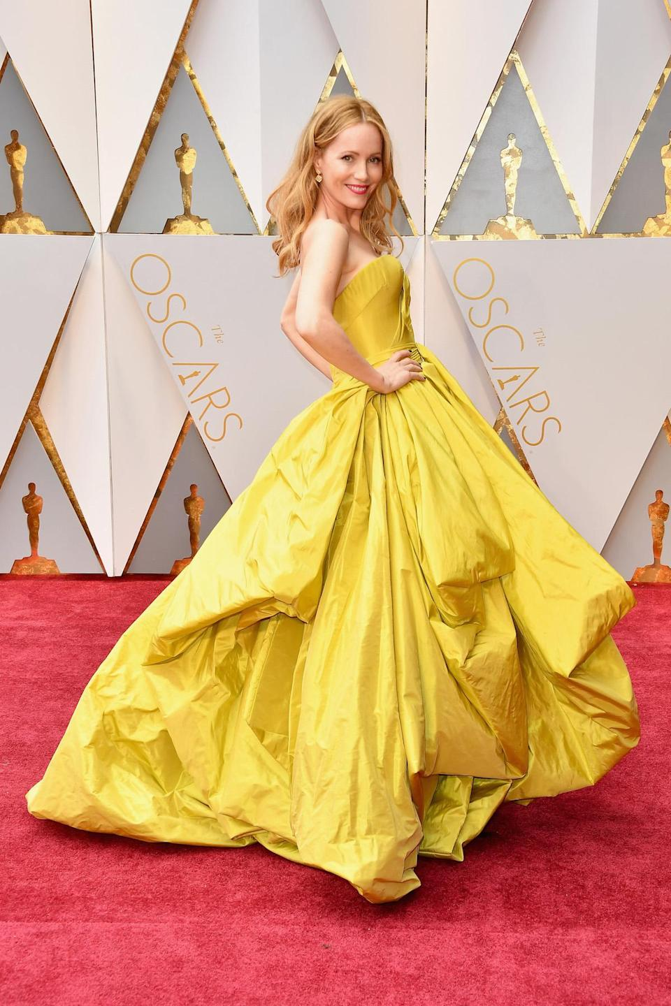 <p>Leslie Mann channelled Belle from <em>Beauty and the Beast </em>for the Oscars in a yellow Zac Posen gown. <em>(Photo: Getty Images)</em> </p>