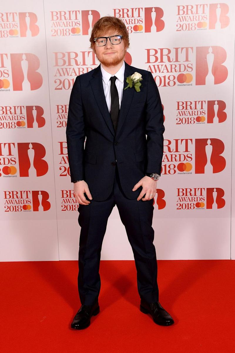 Can you see it? Ed has sparked wedding rumours as he's wearing a ring on his wedding finger at The Brits. Source: Getty