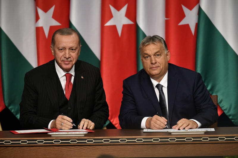 Turkish President Recep Tayyip Erdogan, left, and Hungarian Prime Minister Viktor Orban sign a document during their meeting in Budapest, Hungary, Thursday, Nov. 7, 2019. (Zsolt Szigetvary/MTI via AP)