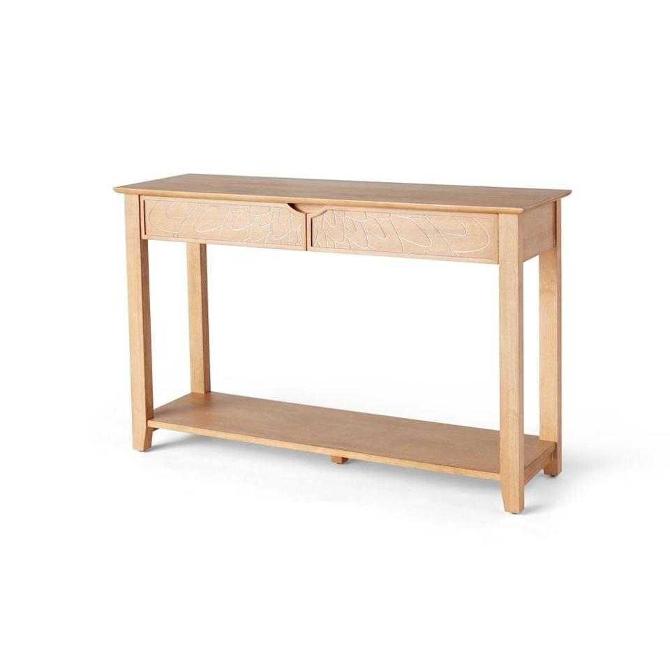 <p>This <span>Drew Barrymore Flower Home Carved Wood Console Table</span> ($229) is so easy to place in your home, and it adds both style and storage.</p>