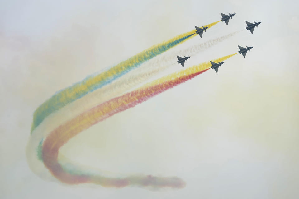 """Members of the """"August 1st"""" Aerobatic Team of the Chinese People's Liberation Army (PLA) Air Force perform during the 13th China International Aviation and Aerospace Exhibition, also known as Airshow China 2021, on Tuesday, Sept. 28, 2021, in Zhuhai in southern China's Guangdong province. (AP Photo/Ng Han Guan)"""