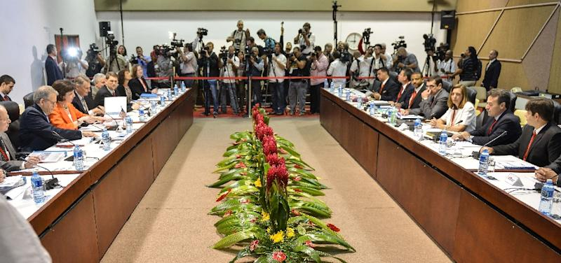 Delegations from the United States and Cuba meet for closed-door talks at the Convention Palace in Havana, on January 22, 2015 (AFP Photo/Adalberto Roque)