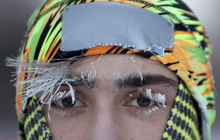 Frost covers part of the face of University of Minnesota student Daniel Dylla during a morning jog along Mississippi River Parkway on Jan. 29, 2019, in Minneapolis. (Photo: David Joles/Star Tribune via AP)