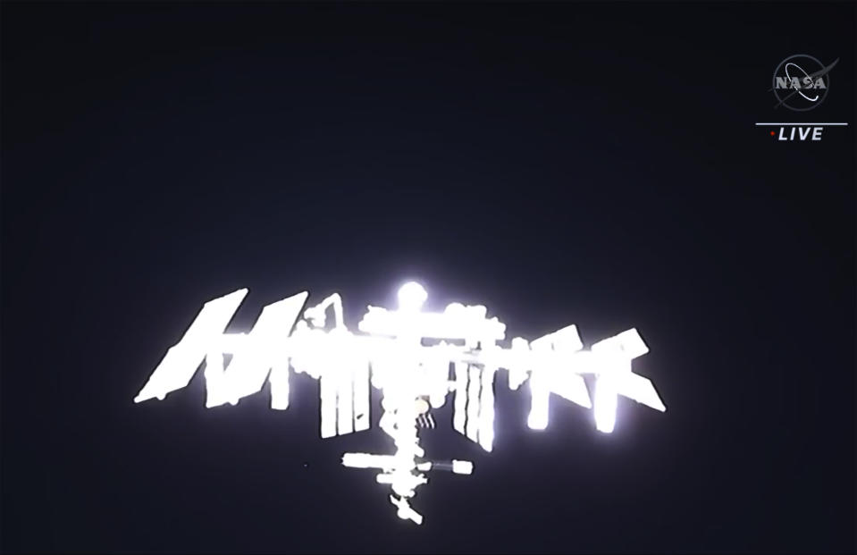 In this image made from NASA TV, the international space station is lit by sunlight as its seen from the SpaceX Crew Dragon spacecraft, Saturday, April 24, 2021. The recycled SpaceX capsule carrying four astronauts has arrived at the International Space Station, a day after launching from Florida. (NASA via AP)