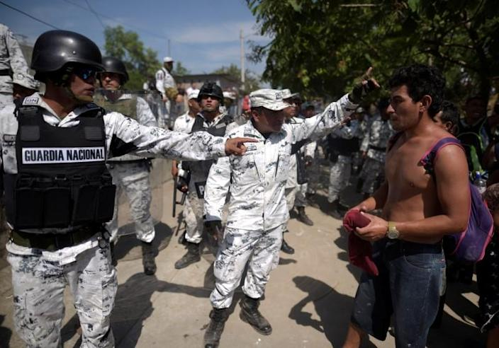 Members of Mexico's National Guard block migrants who crossed the Suchiate river from Tecun Uman, in Guatemala, to Ciudad Hidalgo
