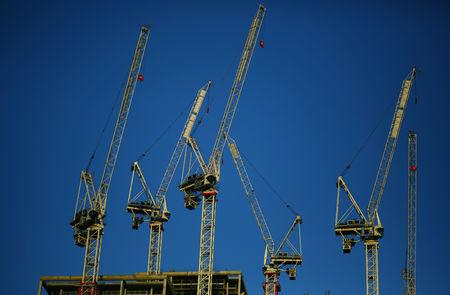 Cranes fill the sky above a construction site in central London