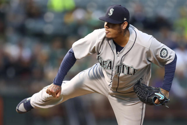 Seattle Mariners pitcher Felix Hernandez works against the Oakland Athletics in the first inning of a baseball game Tuesday, Aug. 14, 2018, in Oakland, Calif. (AP Photo/Ben Margot)