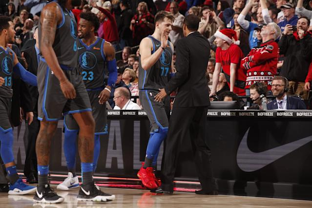 Mavericks rookie Luka Doncic celebrates after hitting a game-tying three at the end of regulation. (Photo by Cameron Browne/NBAE via Getty Images)