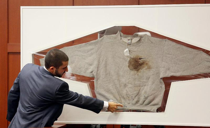 Florida Department of Law Enforcement Crime Lab Analyst Anthony Gorgone points at Trayvon Martin's sweatshirt during the George Zimmerman trial in Seminole circuit court, in Sanford, Fla., Wednesday, July 3, 2013. Zimmerman is charged with second-degree murder in the fatal shooting of Trayvon Martin, an unarmed teen, in 2012. (AP Photo/Orlando Sentinel, Jacob Langston, Pool)